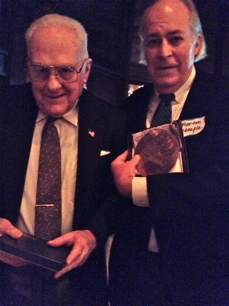 The Director of the Sewickley Historical Society, Harton Semple, (right) rewards Ron Potter (left) with a SVHS Wendell August Forge plaque of the Sewickley Bridge for his historic photographs that added so much to the evening.