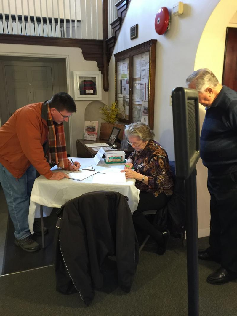 Jerry Andres signs the MTHS guest registry as Patricia and Don Maloney look on.  Don is the Treasurer of MTHS and can be seen at Robin Hill frequently with the Moon Township Garden Club, especially at Christmas time.