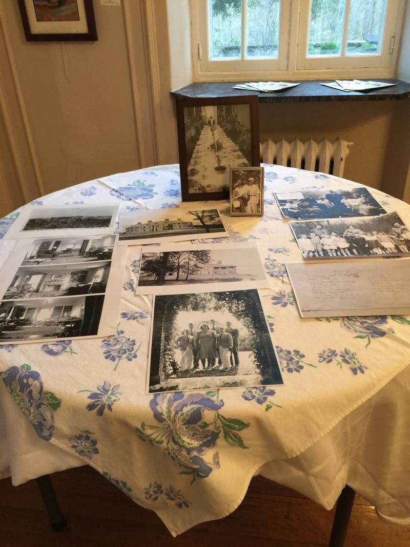 Two tables in the dining room area were set up with many photographs and genealogy charts for visitors to view before and after the formal presentation.